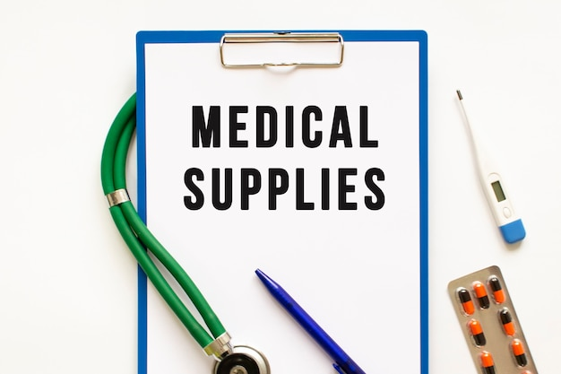 Text medical supplies in the folder with the stethoscope. medical concept photo