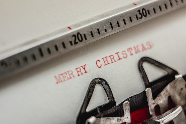 Text merry christmas on retro typewriter