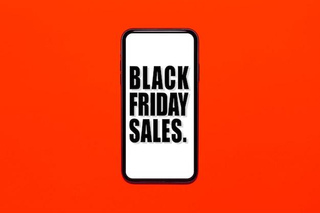 스마트 폰 화면에 검은 금요일 판매 텍스트. 빨간색 또는 무성한 용암 색상의 배경입니다.