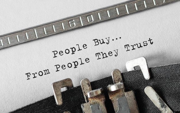 Text people buy from people they trust typed on retro typewriter