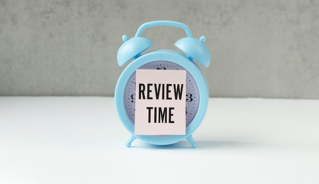 Text review time on blue alarm clock