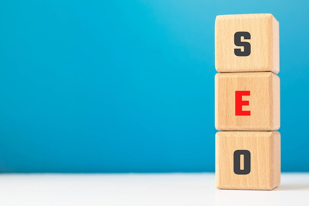 Text seo on wood cubes. abbreviature of 'search engine optimization'.