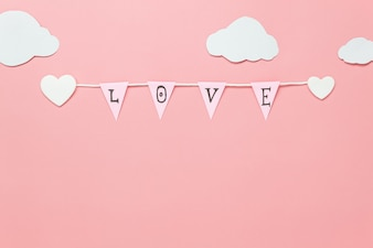 Text sign of season with paper cut clothesline love on beautiful pink sky with cloud.