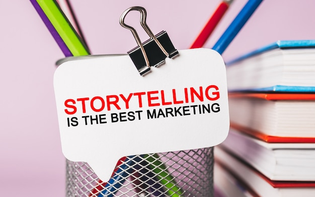 Text storytelling is the best marketing on a white sticker with office stationery background. flat lay on business, finance and development concept