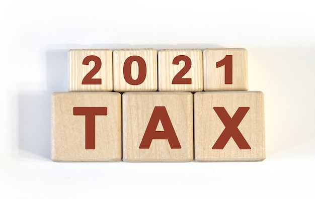 Text - tax 2021 on wooden cubes, on wooden background