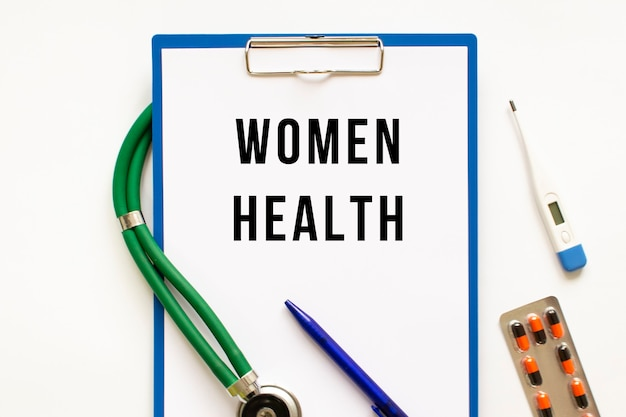 Text women health in the folder with the stethoscope