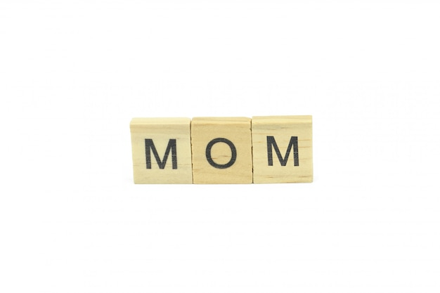 Text wooden blocks spelling the word mom on white