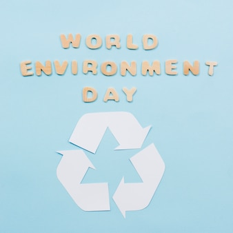 Text world environment day and recycle symbol on blue background