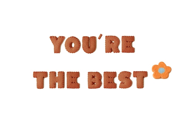 Text of youre the best spelled with chocolate alphabet cookies and orange marshmallow candy