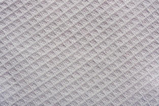 Текстильный фон из серой текстурированной скатерти крупным планом