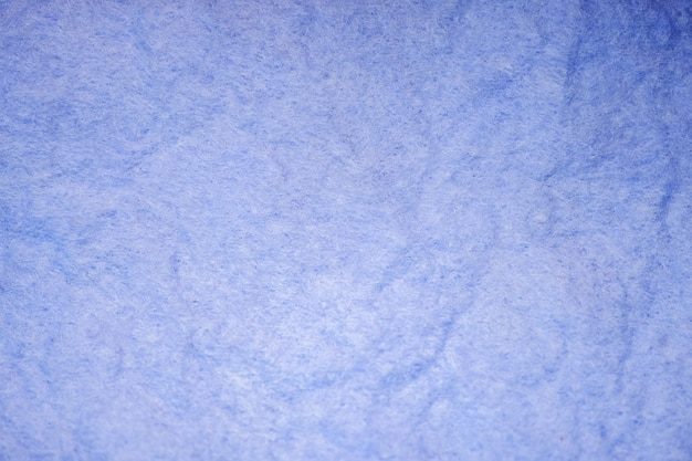 Textile background from a blue textured cloth close-up