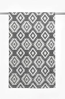 Текстильный фон из шерстяного пледа с крупным планом геометрического узора, изолированного на белом