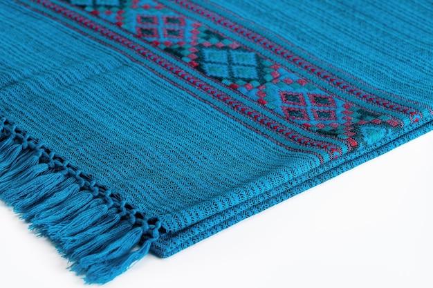 Textile plaid with ornament on wooden background colorful plaids closeup