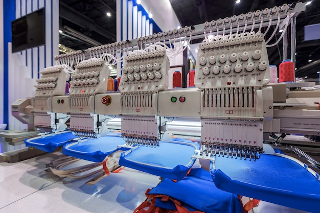 Textile professional industrial embroidery. sewing machine is used to create patterns on t