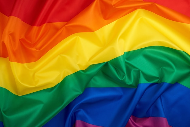 Textile rainbow flag with waves, lgbt culture background