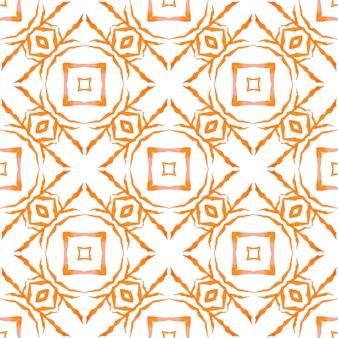 Текстильный готовый экзотический принт, ткань для купальных костюмов, обои, упаковка. оранжевый исключительный летний дизайн в стиле бохо-шик. икат повторяющийся дизайн купальников. акварель икат, повторяющаяся граница плитки.