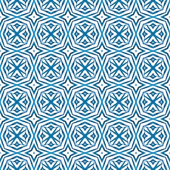 Textile ready fetching print, swimwear fabric, wallpaper, wrapping. blue valuable boho chic summer design. watercolor ikat repeating tile border. ikat repeating swimwear design.
