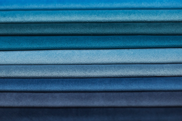 Textile samples for curtains. blue tone curtain samples hanging.