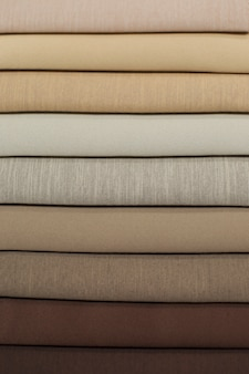 Textile samples for curtains. from light brown to dark brown tone curtain samples hanging.