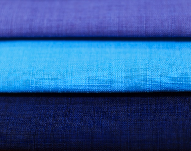 Textile samples. textile samples for curtains. blue tone curtain samples hanging.