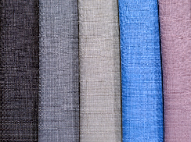 Textile samples. textile samples for curtains. gray, brown, blue tone curtain samples hanging.
