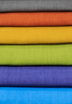 Textile samples. textile samples for curtains. yellow, blue, orange, green tone curtain samples hanging.