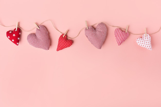 Textile valentines day hearts on pink