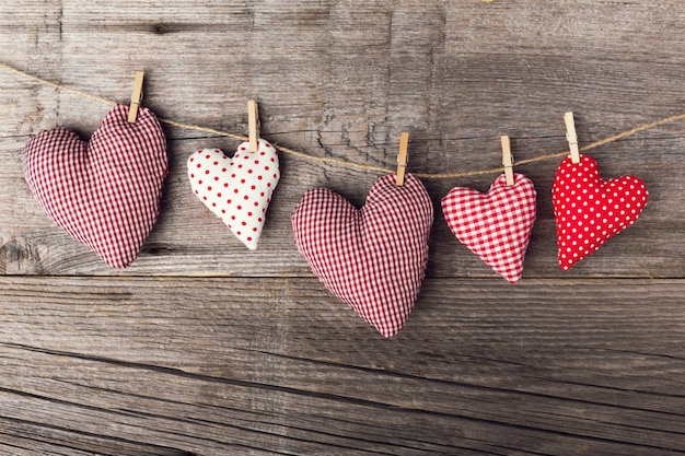 Textile valentines day hearts on wooden