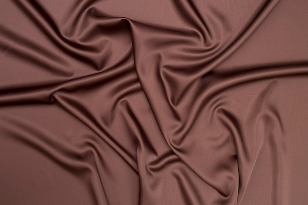 Текстиль абстрактный фон из ткани шоколадного цвета