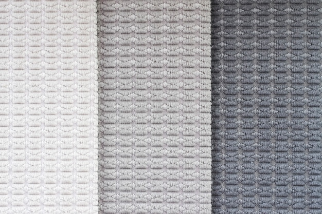 Textiles in gray shades. background fabric close-up.