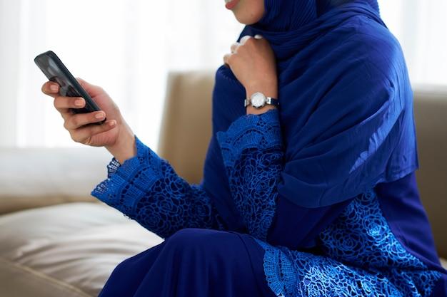 Texting muslim woman