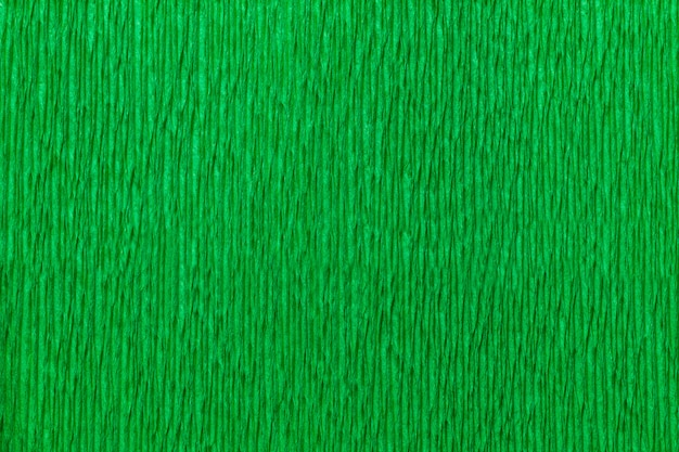 Textural bright green background of wavy corrugated paper