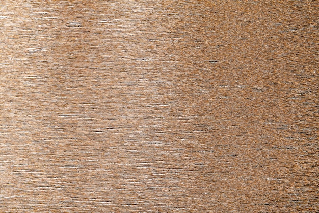 Textural of bronze background of wavy corrugated paper,
