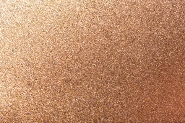Textural of bronze wavy corrugated paper, closeup.