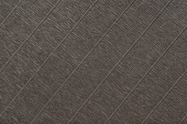 Textural of dark brown background of wavy corrugated paper