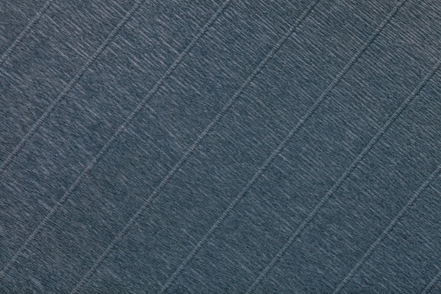 Textural of dark gray background of wavy corrugated paper