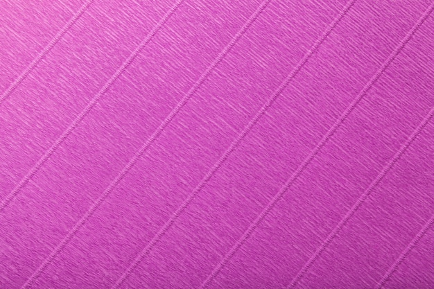 Textural of dark purple background of wavy corrugated paper, closeup.