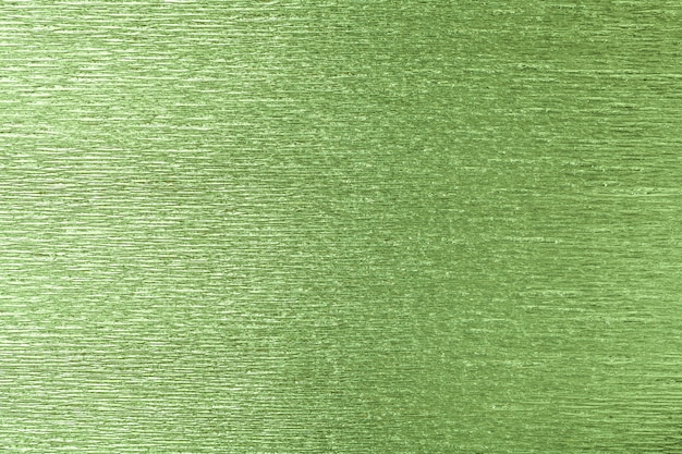 Textural of green of wavy corrugated paper, closeup.