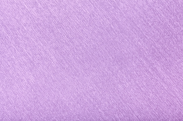 Textural of lilac wavy corrugated paper, closeup.