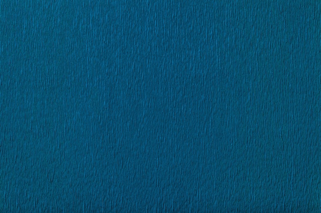 Textural of navy blue of wavy corrugated paper, closeup.