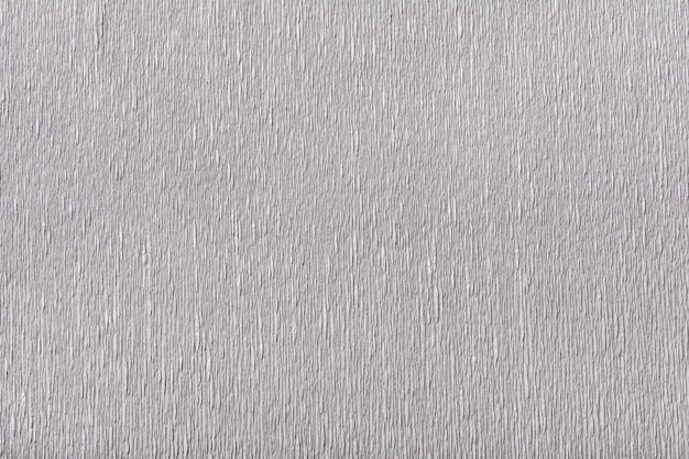 Textural of silver background of wavy corrugated paper, closeup.