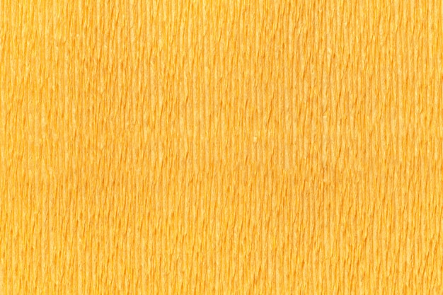 Textural yellow background of wavy corrugated paper