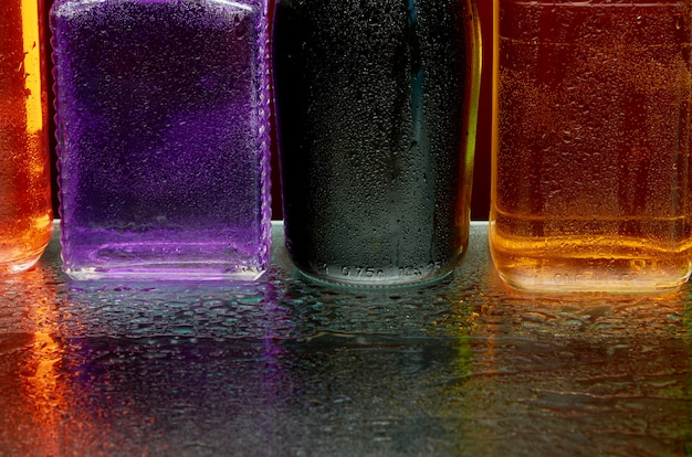 The texture of alcoholic beverages by the glass in a spray of water