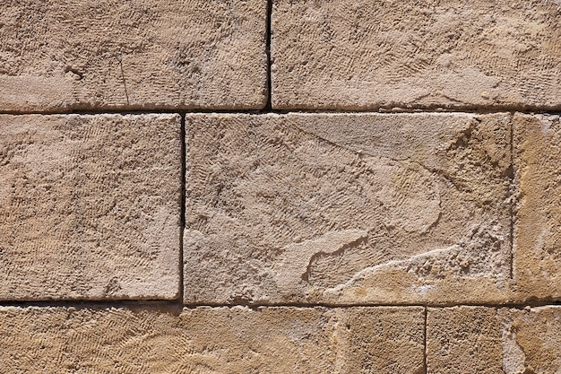 The texture of an ancient brick wall as a vintage background.