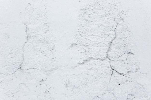 テクスチャと背景 古いコンクリートの壁のひび割れ 修理と建設