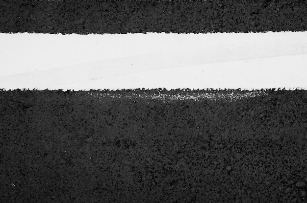 Texture of asphalt road with white dashed line top view background