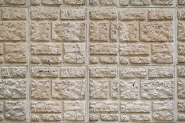 テクスチャ背景ベージュの装飾的な石のタイル