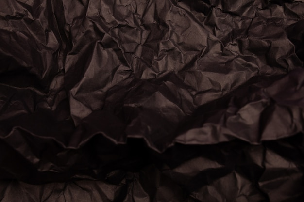 Texture or background of detailed black toned crumpled paper