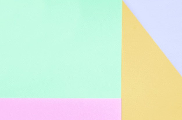 Texture background of fashion pastel colors. pink, violet, orange and blue geometric papers.