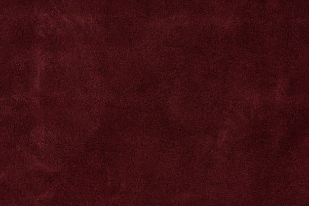 Texture background from burgundy leather suede